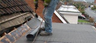 Сколько стоит покрыть крышу рубероидом