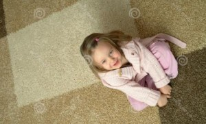 http://www.dreamstime.com/royalty-free-stock-photography-small-girl-sitting-carpet-image2178117